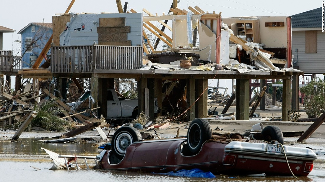 A home and a car lie amid the debris of Hurricane Ike on September 17, 2008, in Crystal Beach, Texas.
