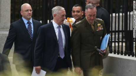 US Defense Secretary James Mattis (L) and Chairman of the Joint Chiefs of Staff Joseph Dunford are seen on West Executive Drive after briefing US senators on the situation in North Korea in the Eisenhower Executive Office Building, next to the White House on April 26, 2017 in Washington, DC. / AFP PHOTO / MANDEL NGAN        (Photo credit should read MANDEL NGAN/AFP/Getty Images)