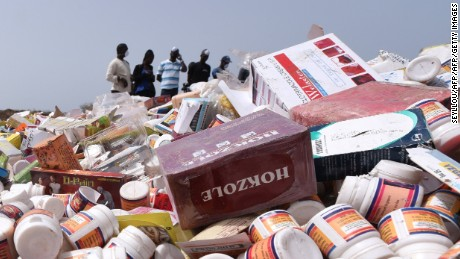 "People work to destroy, on April 21, 2015 at the Champ de tir des Mamelles in Dakar, about 4 tonnes of counterfeit and illegal medicine seized in an operation as part of the fight against pharmaceutical crime, called ""Porc-Epic"" (porcupine). The operation was initiated simultaneously in ten other countries in the sub-region over three days (May 27, 28 and 29, 2014), in collaboration with Senegal's Directorate of Pharmacy and Medicine and Senegal's College of Pharmacists. AFP PHOTO / SEYLLOU        (Photo credit should read SEYLLOU/AFP/Getty Images)"