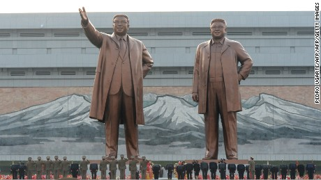 North Koreans soliders and officials pay their respects in front of statues of the nation's former leaders Kim Il-Sung (L) and Kim Jong-Il (R) during an unveiling ceremony in Pyongyang on April 13, 2012. North Korea's new leader Kim Jong-Un on April 13 led a mass rally for his late father and grandfather following the country's failed rocket launch. AFP PHOTO/PEDRO UGARTE (Photo credit should read PEDRO UGARTE/AFP/Getty Images)