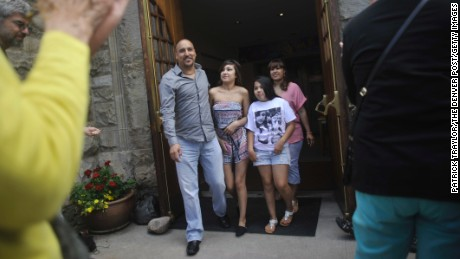 DENVER, CO - JULY 21: (From left) Arturo Hernandez Garcia, followed by his daughters Mariana and Andea and his wife Ana, emerge for a press conference at First Unitarian Society. The 42-year-old Mexican national, who for the last nine months has been living in the basement of the church to avoid deportation, received a letter from immigration officials telling him he is no longer an enforcement priority. (Photo by Patrick Traylor/The Denver Post via Getty Images)