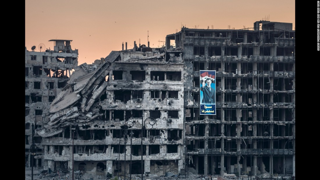 An election campaign poster for President Bashar al-Assad is displayed on a ruined shopping mall in the Khalidiya district of Homs, shortly after government forces regained control of the area. Built just before the war, the mall never opened for business. (June 15, 2014)