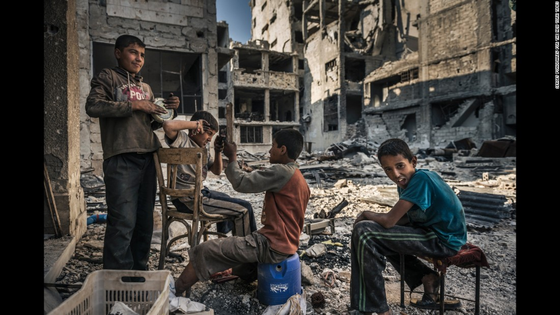 Homeless children play in the ruins of Homs after opposition forces left the area. During the siege, children were left to fend for themselves when their parents went missing or were caught on the wrong side of newly established checkpoints. (June 14, 2014)