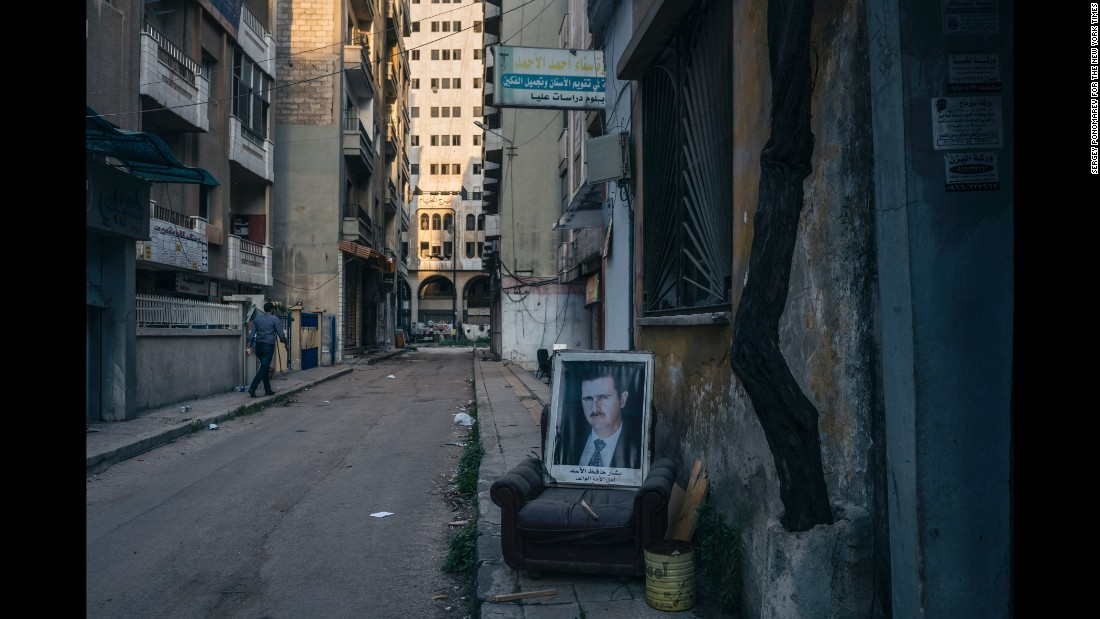 A portrait of the President is displayed on a chair in the government-controlled sector of Homs, 40 meters from the sniper-controlled frontline that divided the city. (March 23, 2014)