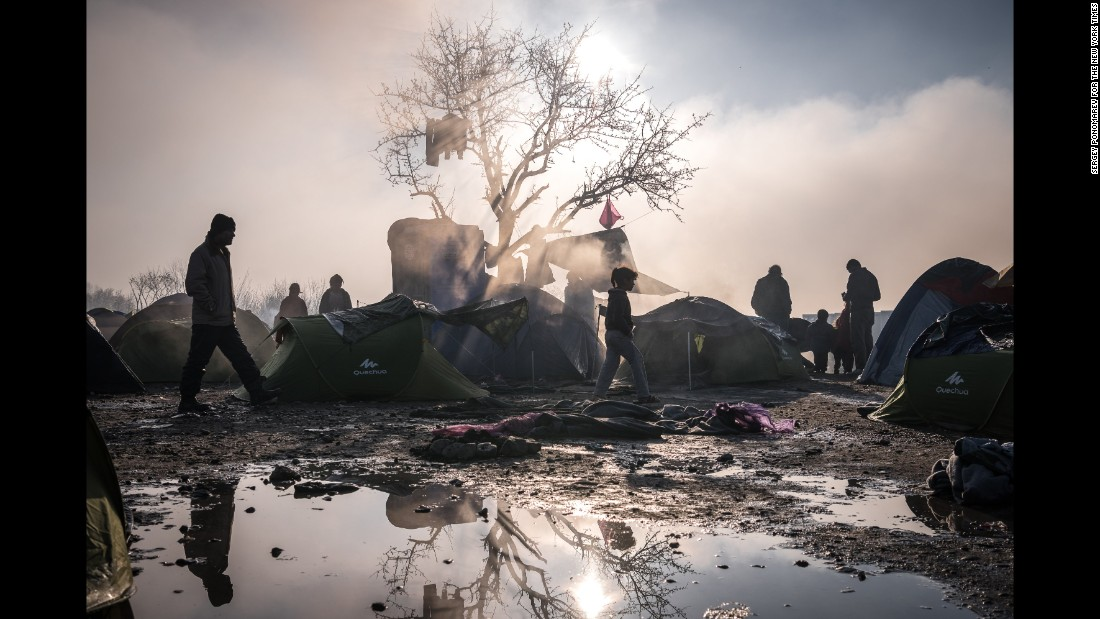 Refugees and migrants, who were refused entry to Macedonia, camp in harsh winter conditions near the closed border crossing. (March 11, 2016)