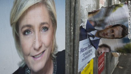 Campaign posters of French presidential election candidates Marine Le Pen and Emmanuel Macron in the Le Pen stronghold of Henin-Beaumont, northern France.