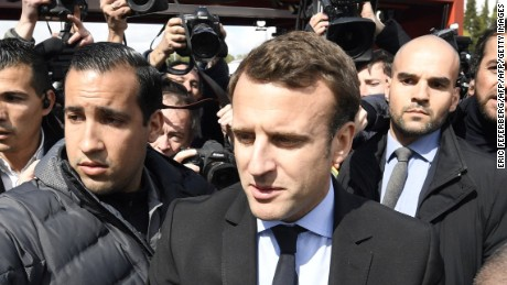 TOPSHOT - French presidential election candidate for the En Marche ! movement Emmanuel Macron arrives outside Whirlpool factory outside the Amiens Cathedral on April 26, 2017. Macron announced that he would meet with employees of the under-threat Whirlpool factory in Amiens after French far-right presidential candidate Marine Le Pen upstaged him by making a surprise visit to the factory as he was meeting workers' representatives without actually visiting the site. / AFP PHOTO / POOL / Eric FEFERBERG        (Photo credit should read ERIC FEFERBERG/AFP/Getty Images)