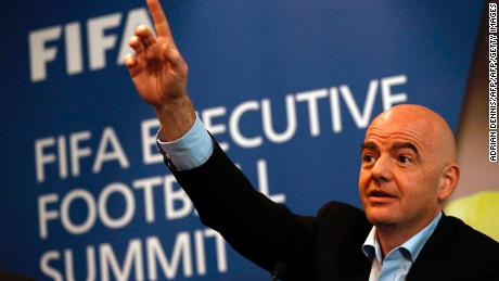 FIFA President Gianni Infantino gestures while talking with journalists during a press conference following the FIFA Executive Football Summit near Heathrow airport in London on March 9, 2017.  Barcelona's extraordinary fightback to beat Paris Saint-Germain in the Champions League demonstrated football's unique capacity for surprise, FIFA president Gianni Infantino said. / AFP PHOTO / ADRIAN DENNIS        (Photo credit should read ADRIAN DENNIS/AFP/Getty Images)
