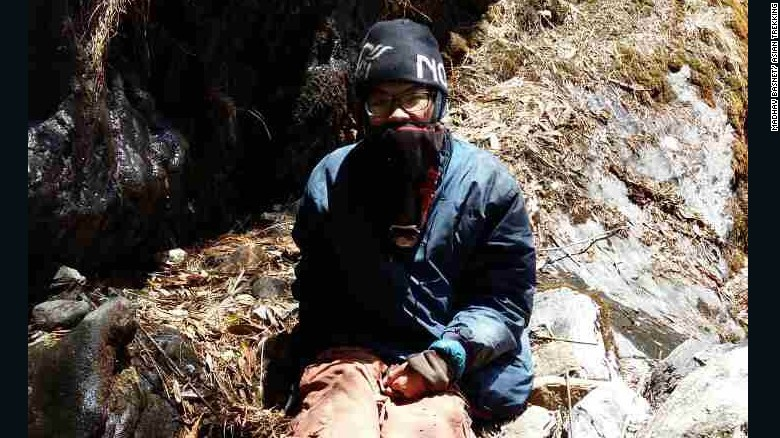 """Taiwanese hiker Liang Sheng-yue, seen at the site of his rescue. He was conscious when the search party found him, but """"very tired,"""" and had lost 30 kg over the 47 days in the wilderness."""