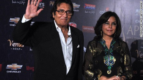 "Indian Bollywood actors Vinod Khanna and Zeenat Aman pose as they arrive for the ""7th Apsara Awards"" ceremony in Mumbai on January 25, 2012.   AFP PHOTO/STR (Photo credit should read STRDEL/AFP/Getty Images)"
