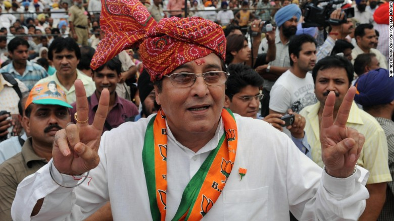 Vinod Khanna makes a victory sign during an election campaign rally on the outskirts of Gurdaspur, India.