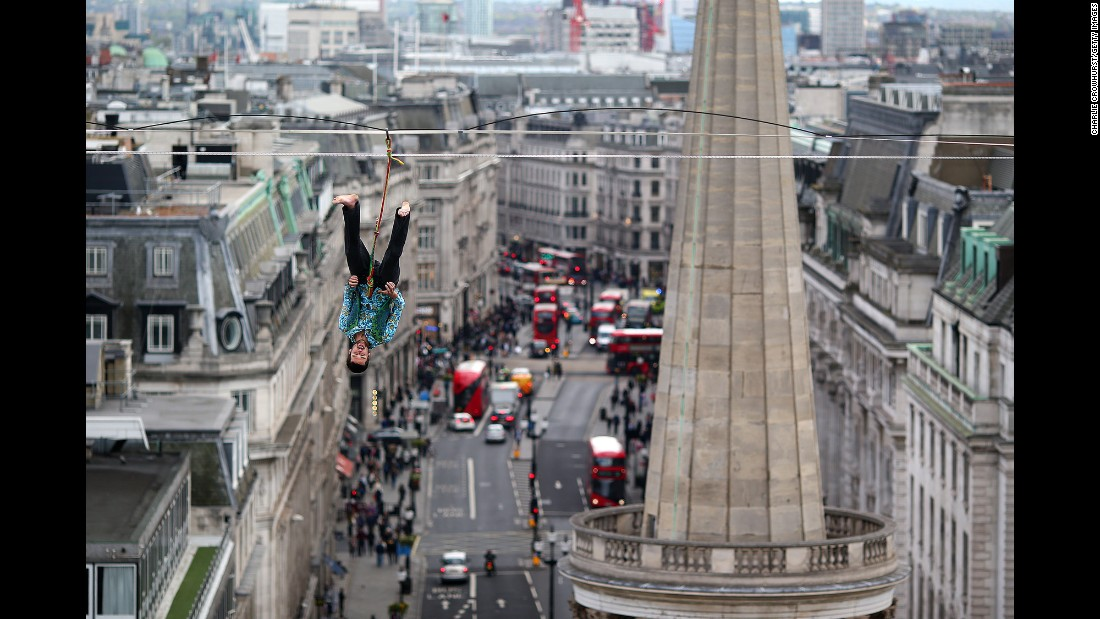 "One of the Flying Frenchies -- stars of the new film ""The Free Man"" -- hangs from a high wire near the BBC Broadcasting House in London on Tuesday, April 25."