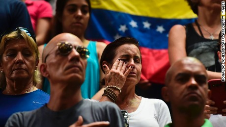 People react during a National Assembly session held at Parque Miranda sport center in Caracas on April 27, 2017.  / AFP PHOTO / RONALDO SCHEMIDT        (Photo credit should read RONALDO SCHEMIDT/AFP/Getty Images)