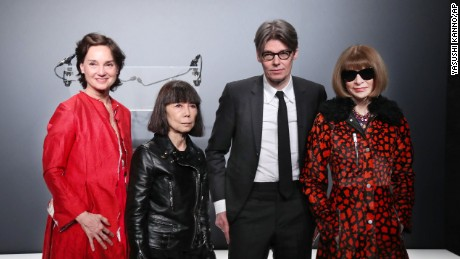 From left: Carrie Rebora Barratt, Rei Kawakubo, Andrew Bolton and Anna Wintour at a Paris press conference.