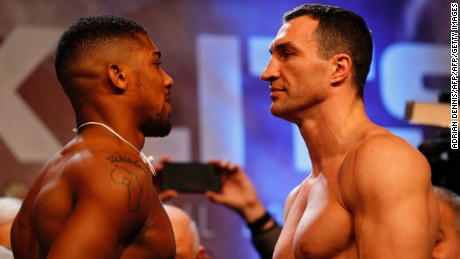 British boxer Anthony Joshua (L) and Ukrainian boxer Wladimir Klitschko (R) face each other during the weigh-in ahead of their world heavyweight title unification bout at Wembley in London on April 28, 2017. British boxer Anthony Joshua bids to add the World Boxing Association (WBA) belt and retain his International Boxing Federation (IBF) title when he fights Ukrainian Wladimir Klitschko at Wembley on April 29. / AFP PHOTO / Adrian DENNIS        (Photo credit should read ADRIAN DENNIS/AFP/Getty Images)