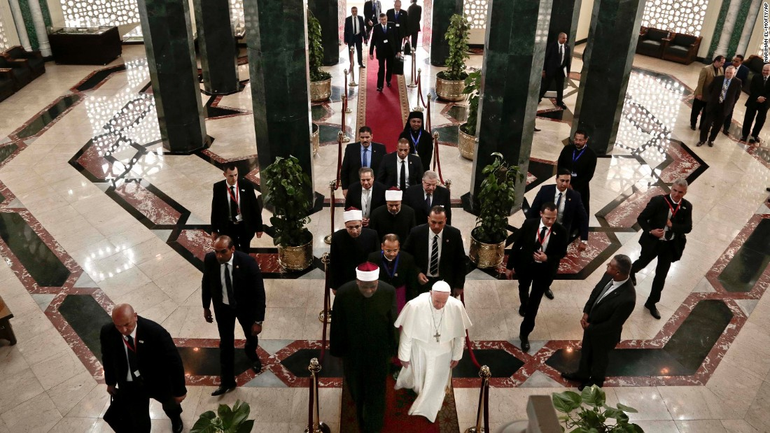 The Pope arrives for his meeting with the Grand Imam.