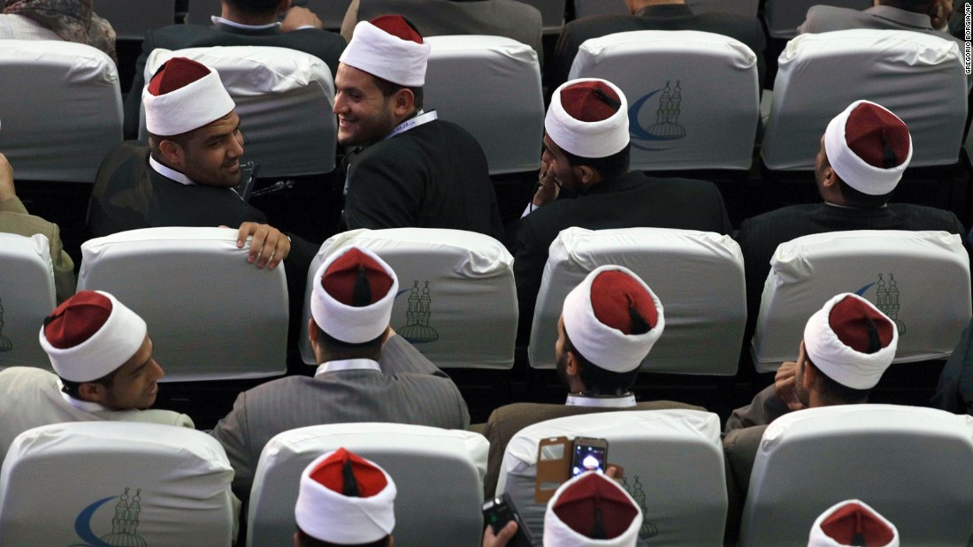 Muslim scholars wait for the peace conference to begin.