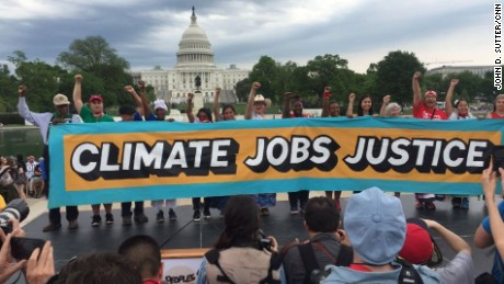 Protesters at the People's Climate March call for action on climate change in Washington D.C. on Saturday, April 29.