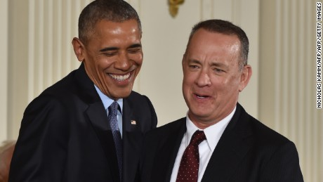 US President Barack Obama smiles before presenting actor Tom Hanks with the Presidential Medal of Freedom, the nation's highest civilian honor, during a ceremony honoring 21 recipients, in the East Room of the White House in Washington, DC, November 22, 2016. / AFP / Nicholas Kamm        (Photo credit should read NICHOLAS KAMM/AFP/Getty Images)