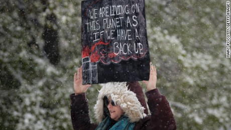 Leah Stein of Parker, Colorado holds a sign while protesting at the People's Climate March on Denver on April 29, 2017 in Denver, Colorado. The protest, which focused on climate change, coincided with President Donald Trump's 100th day in office.