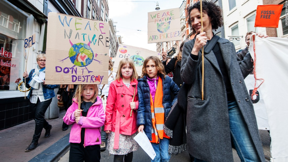 People take part in a climate march in Amsterdam, Netherlands.