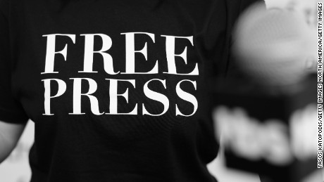 "WASHINGTON, DC - APRIL 28:  (EDITOR'S NOTE: This image has been converted to black and white) A person stands at a podium in one of the ""Free Press"" t shirts handed out during the Full Frontal With Samantha Bee's Not The White House Correspondents' Dinner activation at the Newseum on April 28, 2017 in Washington City. 26966_005  (Photo by Tasos Katopodis/Getty Images)"