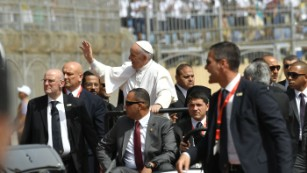 Security surrounds Pope Francis at the Air Defense Stadium in Cairo.