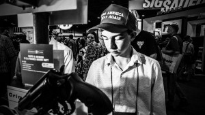 14 year old Noah Lynn of dunwoody ga on the NRA convention floor looking at handguns after hearing president trump address the nra in atlanta ga