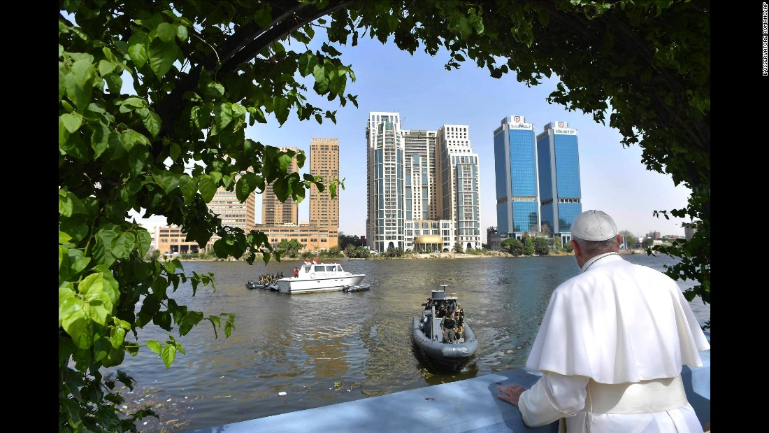 Pope Francis looks over the Nile from a terrace during a meeting with clergy and religious leaders in Cairo.