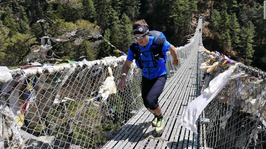 Steck crosses a bridge during a training run in Nepal's Khumbu Valley.