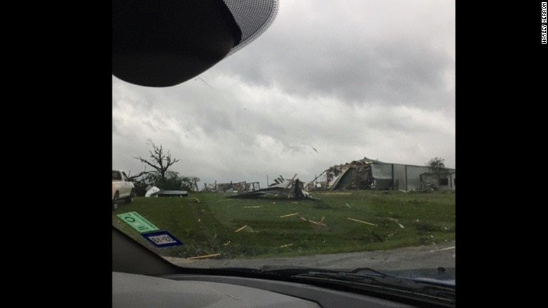 "Hayley Herron, 17, lives in Canton, Texas. She and her family went out to see the damage between the second and third storms. ""The damages were horrible,"" she said."