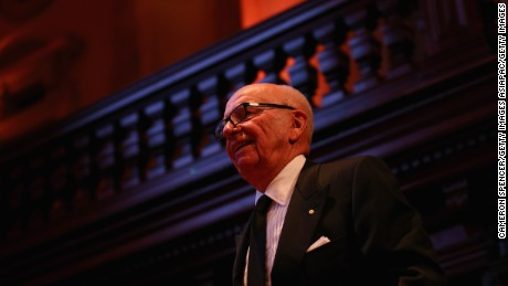 SYDNEY, AUSTRALIA - OCTOBER 31:  News Corp executive chairman, Rupert Murdoch walks on stage to deliver a speech on October 31, 2013 in Sydney, Australia. Murdoch delivered the 10th annual lecture at the Lowy Institute's annual black tie event in Sydney.  (Photo by Cameron Spencer/Getty Images)