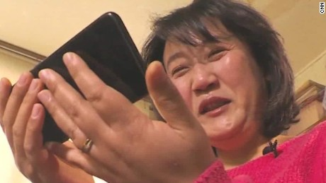 Kim Ryon Hui watches videos from her family in the North.