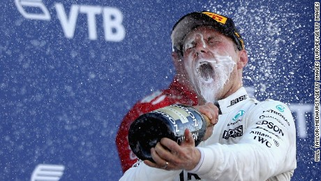SOCHI, RUSSIA - APRIL 30:  Race winner Valtteri Bottas of Finland and Mercedes GP celebrates on the podium during the Formula One Grand Prix of Russia on April 30, 2017 in Sochi, Russia.  (Photo by Will Taylor-Medhurst/Getty Images)