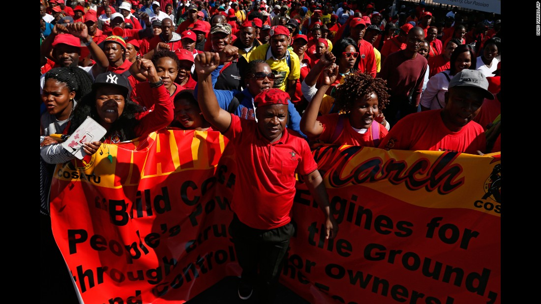 Workers in South Africa take part in a May Day march to the Johannesburg Stock Exchange building.