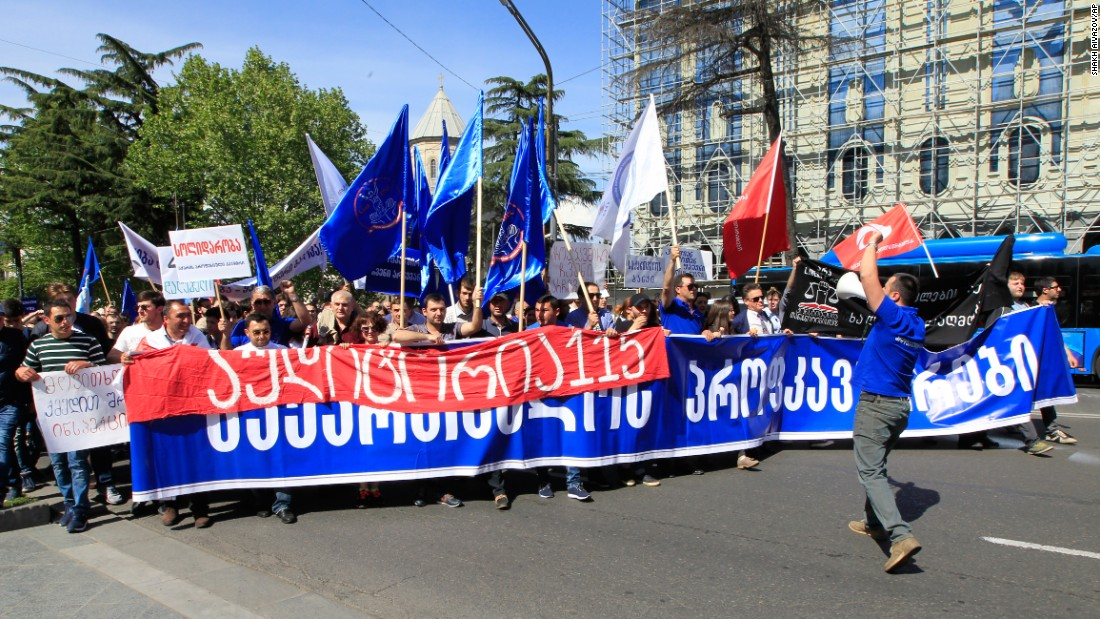 "Students hold a banner reading ""Georgian Trade Unions"" as they march on May Day in Tbilisi, Georgia."