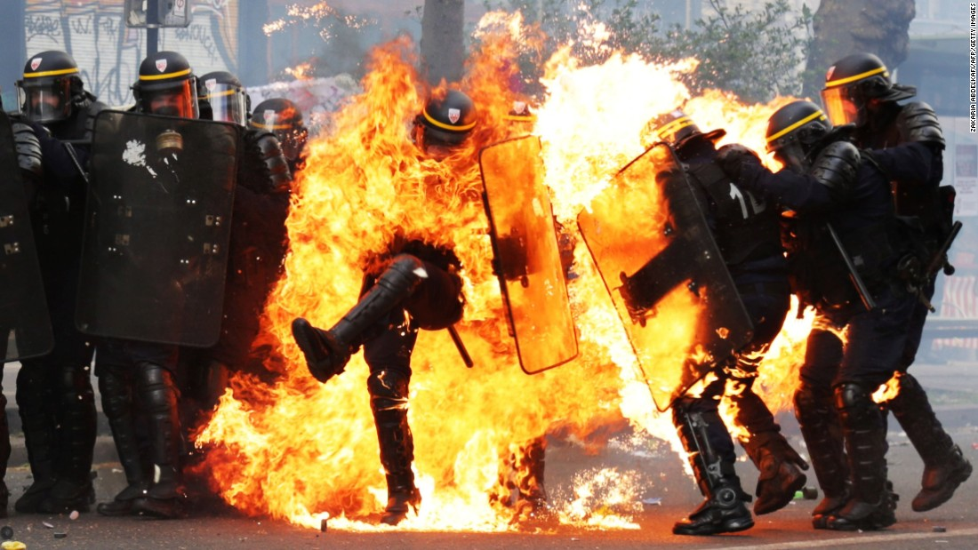 "Police officers in Paris are engulfed in flames as they clash with May Day protesters on Monday, May 1. May Day protests <a href=""http://www.cnn.com/2017/05/01/world/may-day-celebrations-protests-around-world/"" target=""_blank"">turned violent</a> in several cities around the world."
