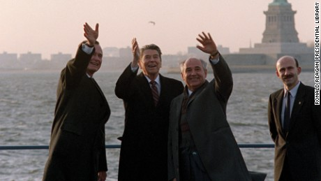 "Ronald Reagan, Mikhail Gorbachev, George Bush all wave to the press corps. Film still from ""The Reagan Show."""