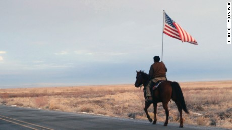 "Duane Ehmer rides out to confront the press after the killing of Lavoy Finicum. Film still from ""No Man's Land."""