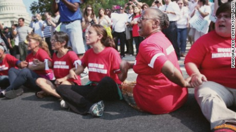 "ACORN staffer Bertha Lewis at a DC protest in ""Acorn and the Firestorm."""