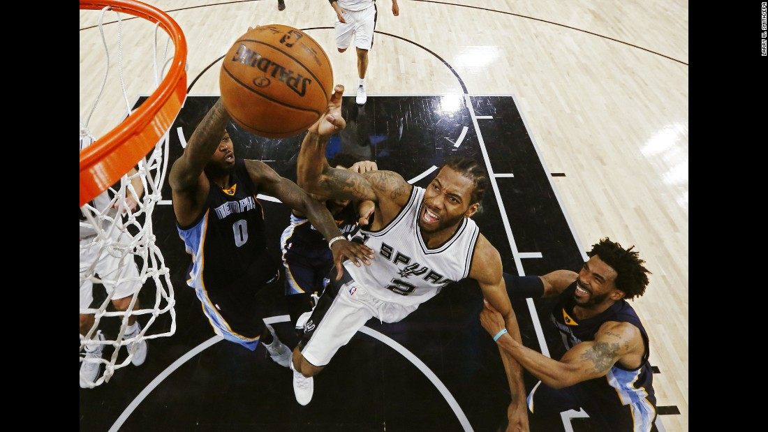 Kawhi Leonard is fouled as he drives to the hoop during an NBA playoff game in San Antonio on Tuesday, April 25. Leonard had 28 points as the Spurs defeated Memphis 116-103, and they closed out the series two days later.