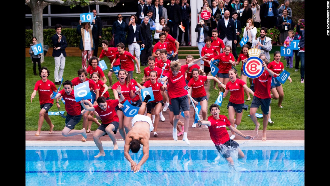Tennis star Rafael Nadal dives into a swimming pool with ball boys and girls after winning the Barcelona Open in Spain on Sunday, April 30. It was the 10th time he won the tournament.