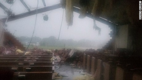 The tornado destruction inside St. John the Evangelist Catholic Church in Emory.