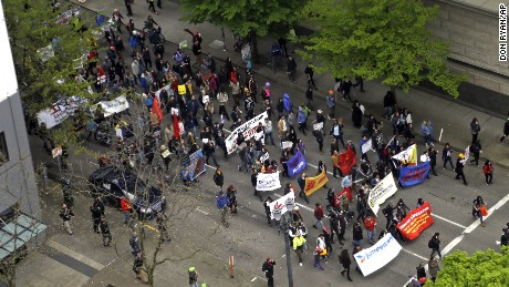 Protesters march through the streets in Portland, disrupting traffic.