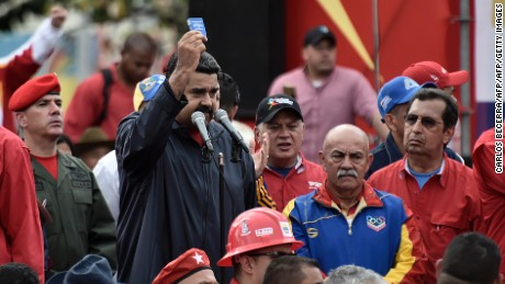 Venezuelan President Nicolas Maduro delivers a speech during a rally on May Day in Caracas, on May 1, 2017. Security forces in Venezuela fired tear gas to drive back protesters Monday as pro- and anti-government May Day rallies erupted exactly one month into a wave of deadly political unrest. Officers clashed with some 300 protesters, some throwing stones, who tried to break through security barriers to the electoral council headquarters in central Caracas.  / AFP PHOTO / Carlos BECERRA        (Photo credit should read CARLOS BECERRA/AFP/Getty Images)