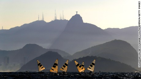 RIO DE JANEIRO, BRAZIL - AUGUST 14:  The Finn Class fleet in action during their second race of the day on Day 9 of the Rio 2016 Olympic Games at the Marina da Gloria on August 14, 2016 in Rio de Janeiro, Brazil.  (Photo by Clive Mason/Getty Images)