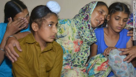Wife of Indian army soldier Paramjit Singh cries with her   children at their residence in Vein Pein village on May 1, 2017.