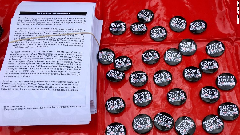 "Boycott 2017 badges at a May Day rally in Paris. The Boycott 2017 campaign calls on voters to back ""neither Le Pen, nor Macron."