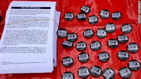 Boycott 2017 badges at a rally in Paris. Boycott 2017 is calling on voters to back neither candidate.