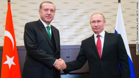 Russian President Vladimir Putin (R) shakes hands with his Turkish counterpart Recep Tayyip Erdogan during their meeting at the Bocharov Ruchei state residence in Sochi on May 3, 2017. / AFP PHOTO / POOL / Alexander Zemlianichenko        (Photo credit should read ALEXANDER ZEMLIANICHENKO/AFP/Getty Images)